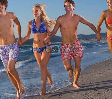young energy group run at beach