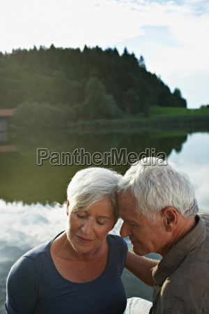 senior couple lying heads to each