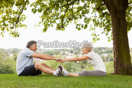 mature couple stretching eachother