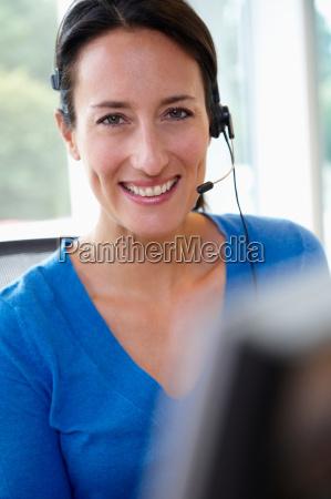 receptionist behind her desk smiling