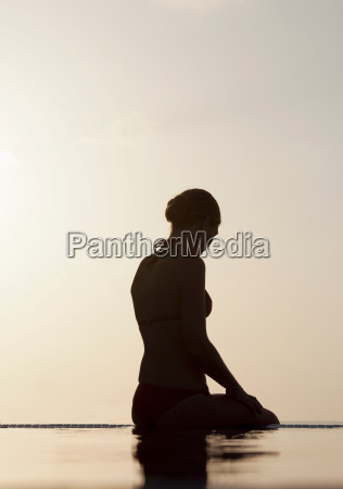 woman sitting at edge of infinity