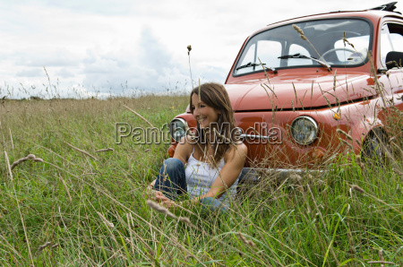 relaxed female by car in countryside