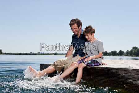 father and son relaxing together on