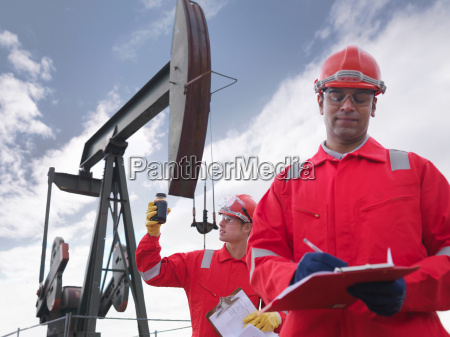 worker inspecting crude oil sample and