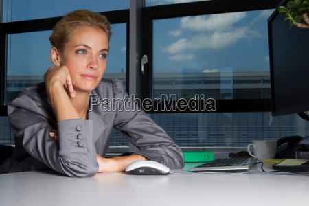 bored businesswoman sitting at desk