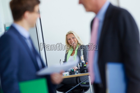 businesswoman smiling at desk in office