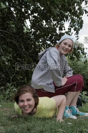 girls exercising together in park