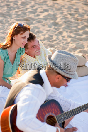 people relaxing together on beach