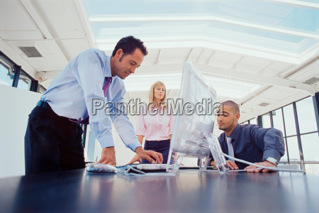 business people working at desk together