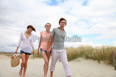 young friends going for a beach