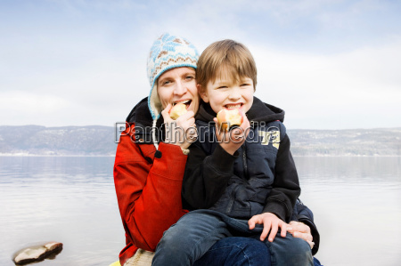 mother and son eating an apple