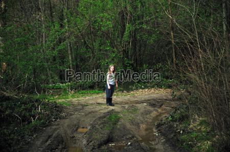 girl walking on dirt road in