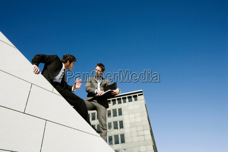 men doing business on roof