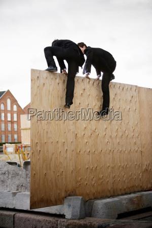 to men climbing wall