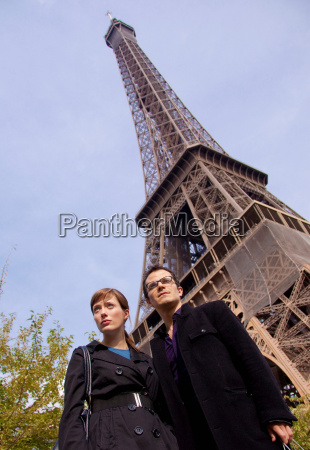 couple stand by eiffel tower paris
