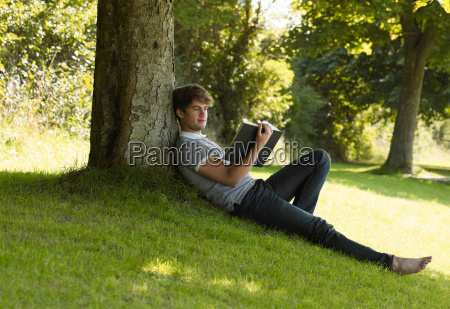 boy reading a book in the