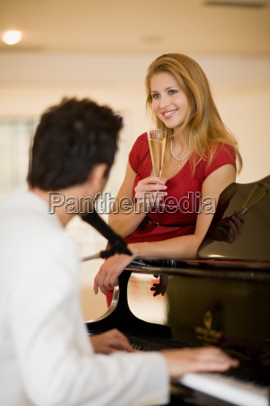 girl leaning on piano