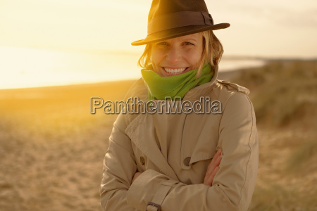 young woman on beach in hat