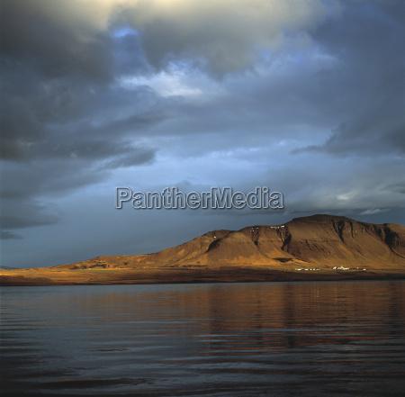 mountain beside still lake