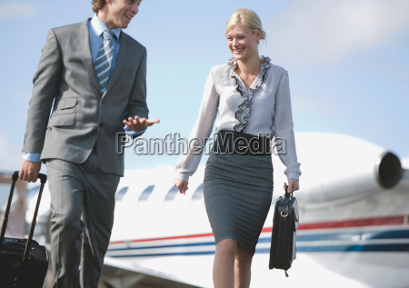 businessman and businesswoman on the move