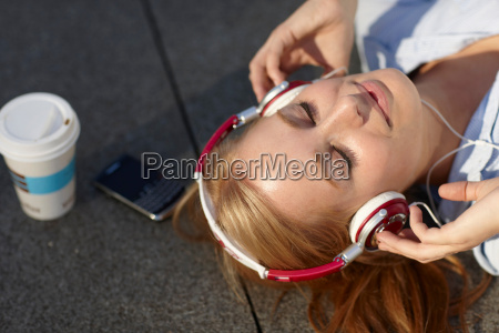 women with headphone with in lunch