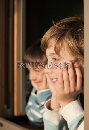 two boys looking out of window
