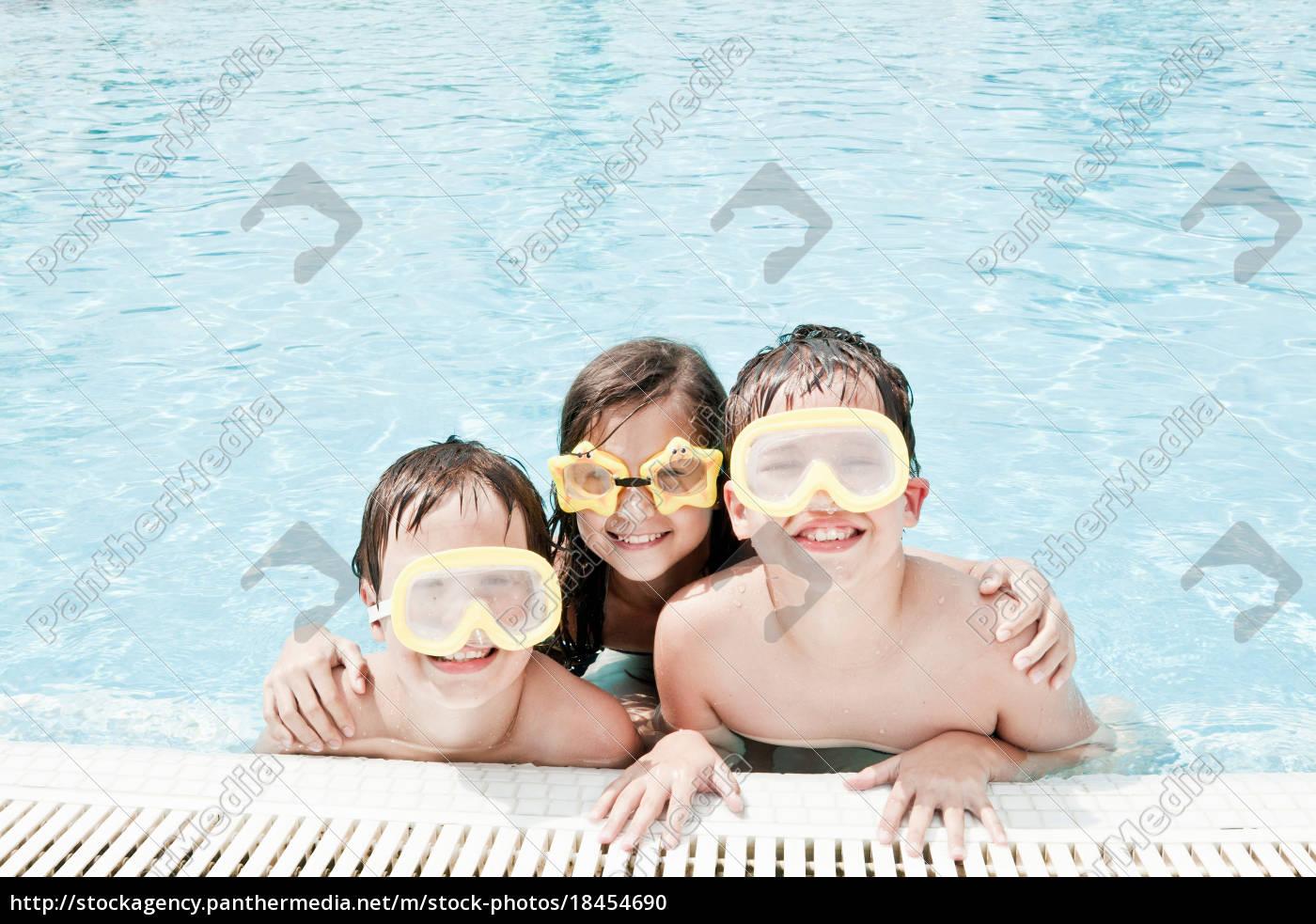 children, in, pool, wearing, swimming, goggle - 18454690