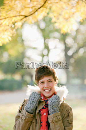 woman under autumn tree in the