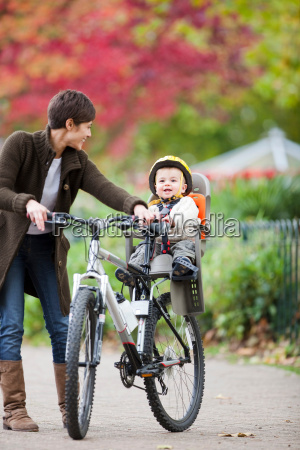 woman and child cycling in the