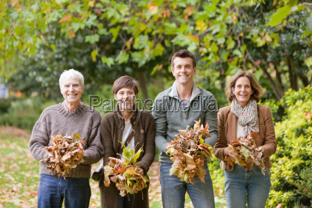 family holding a bunch of leaves