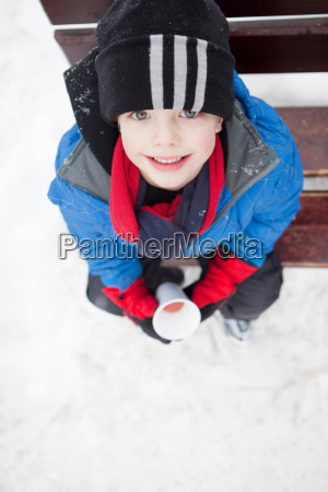 smiling boy on a cold winter