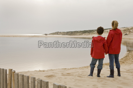 mother and son looking out on