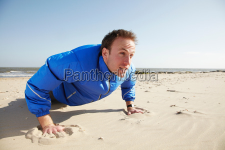 young man doing push ups on