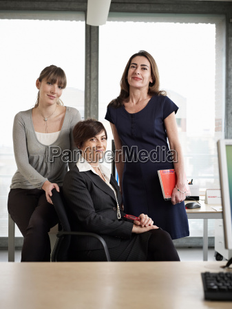 three women in a group meeting