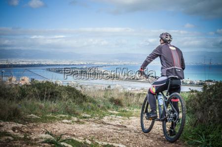 rear view of male mountain biker