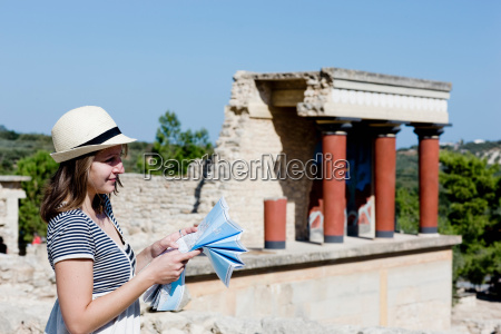 woman looking and holding a map