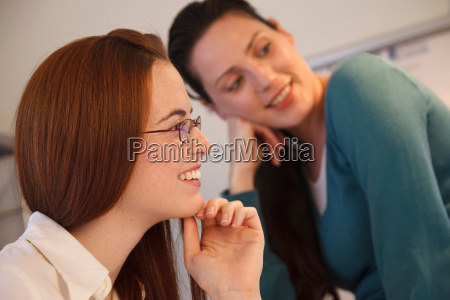 close up of 2 women smiling