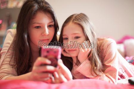 girl playing video game lying on