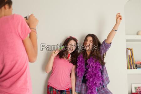 teenage girls singing wearing pyjamas
