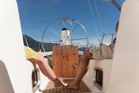 older couple relaxing on sailboat