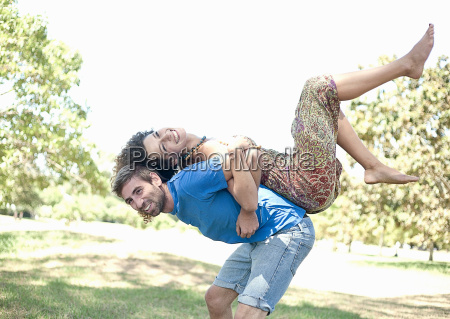 couple playing together in park