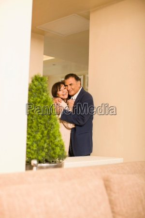older couple hugging in lobby area