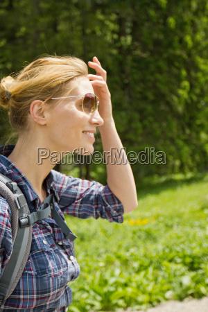 smiling woman wearing hiking backpack