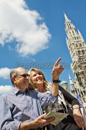 older couple using city map