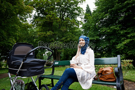 woman in headscarf with stroller in