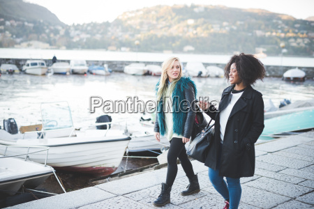 two young female friends strolling at