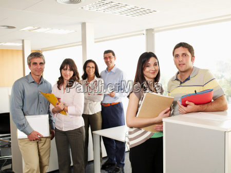 six colleagues standing in office