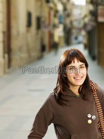 young woman standing in street