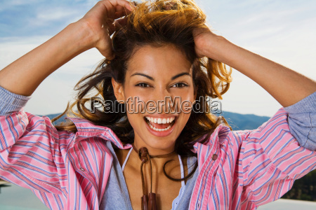 dynamic woman smiles outside