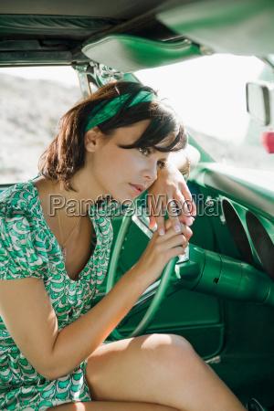 woman in car looking pensive